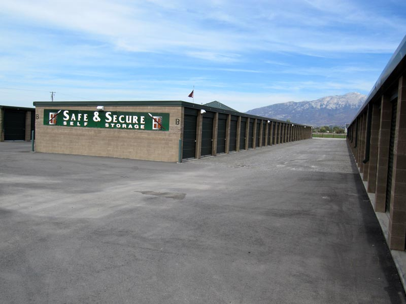 safe and secure self storage building banner and unit doors closeup